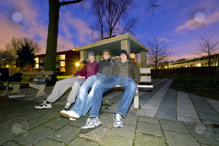 Suburban youth stock photo, Three young men, hanging out in a suburban area in front of a concrete bunker in a playground by Corepics VOF