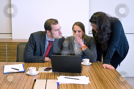 Small Business team stock photo, Three businesspeople working behind a laptop, trying to solve an issue by Corepics VOF