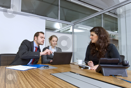 Small business team stock photo, A small business team in a cubicle conference room during a meeting by Corepics VOF