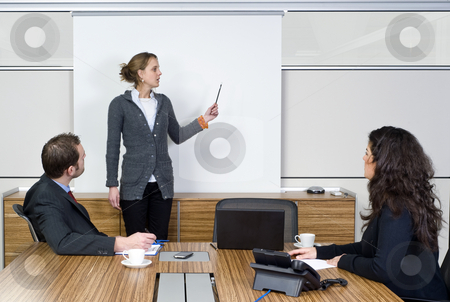 Presentation stock photo, A businesswoman holding a presentation for two of her colleagues by Corepics VOF