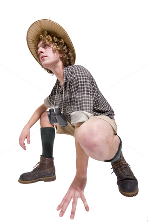 Pathfinder stock photo, A pathfinder in jungle outfit with knee socks, khaki shorts and checkered shirt, crouching. by Corepics VOF