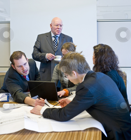 Hectic meeting stock photo, A hectic meeting, with five people working frantically on a design by Corepics VOF
