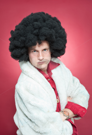 Pimp stock photo, Arrogantly looking man, wearing a wig and a fur coat. by Corepics VOF