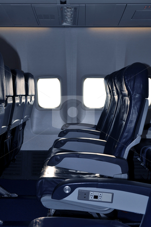 Airliner passenger cabin stock photo, Row of empty seats in commercial aircraft cabin by Fernando Barozza