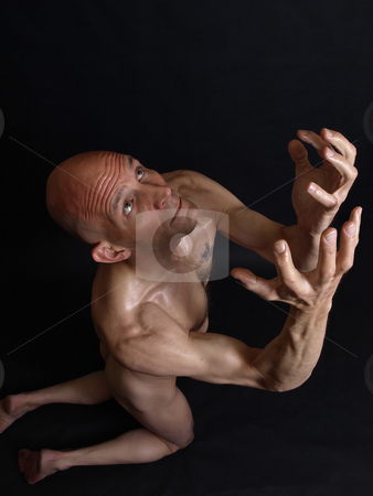 Pleading Male stock photo, A bald and nude male on his knees, pleading, against a black background. by Robert Gebbie