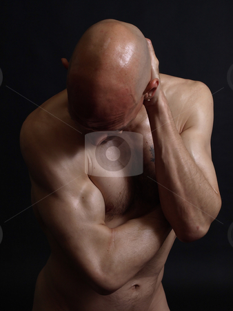 Mr Gym stock photo, A nude bald male holds the back of his head. Over a black background. by Robert Gebbie