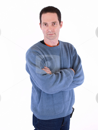 Crossed Arms stock photo, A man in a blue sweater folding his arms, isolated on a white background. by Robert Gebbie