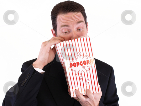 Searching for Popcorn stock photo, Adult male in a suit holding a popcorn bag and looking in. Isolated on a white background. by Robert Gebbie