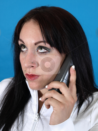 Another Telemarketer stock photo, A woman rolls her eyes as she listens on the telephone. by Robert Gebbie