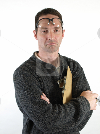 Offering an Opinion stock photo, A man with safety glasses pushed up on his forehead, folds his arms on his chest. by Robert Gebbie