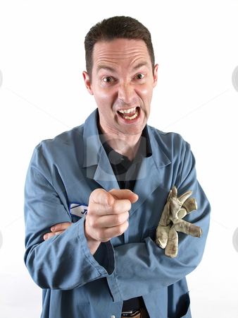 Man Yelling and Pointing stock photo, A man in a blue smock points and yells in anger and frustration. by Robert Gebbie