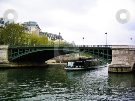 River Seine stock photo, Seine tour boat going under a bridge by Jaime Pharr