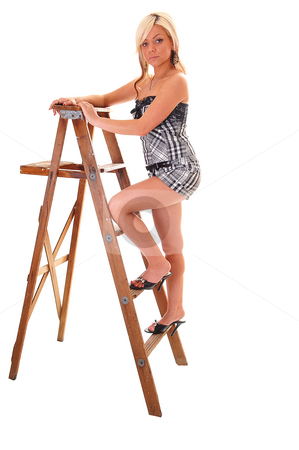 Girl on stepladder. stock photo, Pretty young girl in a black and white top and shorts with long blond hair standing on the wooden stepladder, looking in the camera. by Horst Petzold