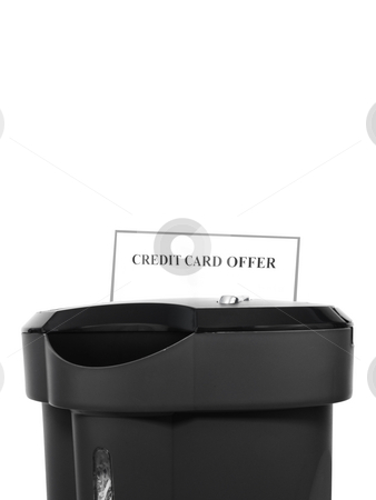 Paper shredder with Credit card offer stock photo, Paper shredder destroying credit card offer by John Teeter