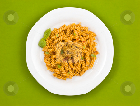 Italian pasta with tomato sauce and basil. stock photo, Italian pasta, fusilli, with tomato sauce and basil. by Pablo Caridad