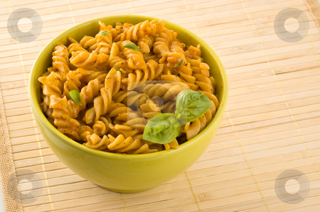 Fresh pasta with tomato sauce and basil. stock photo, Fresh pasta with tomato sauce and basil leaves, close up. by Pablo Caridad