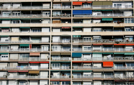 Colored balcony stock photo, Big building with colored balconies in Barcelona by Marc Torrell