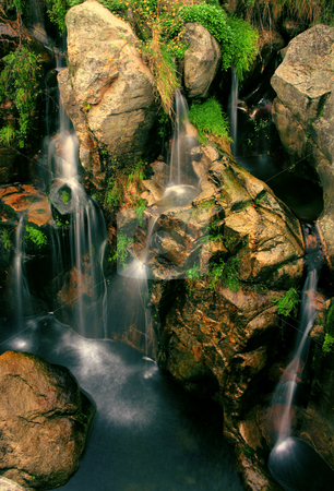 River waterfall stock photo, Movement between the roks of a river and waterfall by Marc Torrell