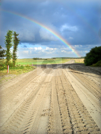 Rainbow on a field stock photo, Rainbow on a sand and grass flat field. by Marc Torrell