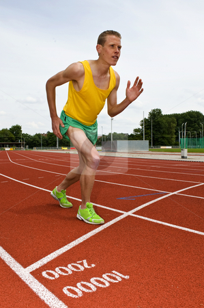 Start stock photo, Athlete, ready for the start of a middle distance race on a running track by Corepics VOF