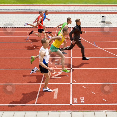 Winning business stock photo, Business metaphore of staying ahead, winning in business,business competition, and continuous improvement, represented by a photo finish of a track race by Corepics VOF