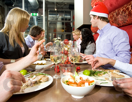 Restaurant dinner stock photo, Group of friends enjoying their christmas dinner in a restaurant by Corepics VOF