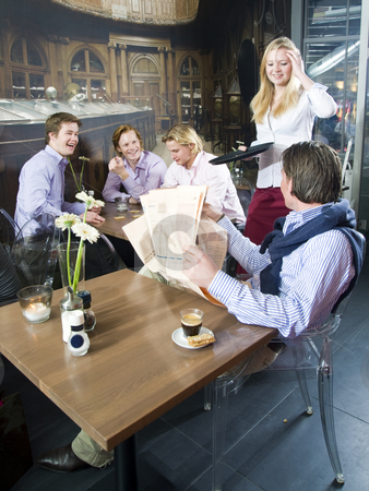 Bar life stock photo, A group of happy people having a drink in a bar by Corepics VOF