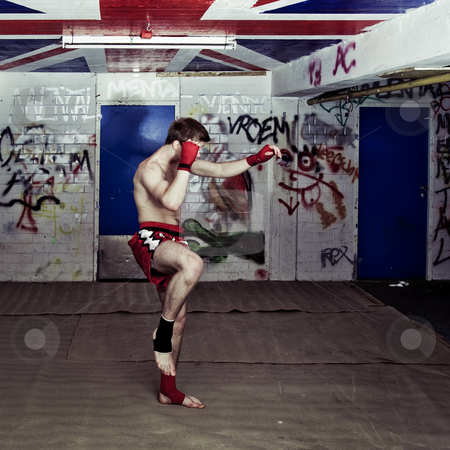 Urban fighter stock photo, An urban street fighter in an graffiti filled basement during a training by Corepics VOF