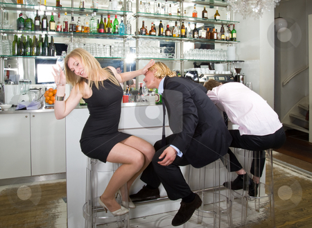 Turning down a flirting male stock photo, A young woman turning down a flirting male at a bar with a sleeping drunk next to them by Corepics VOF