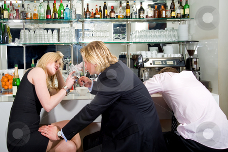 Drunks stock photo, Drunk people slouched over a bar, flirting, sleeping, after a long night with too much to drink by Corepics VOF