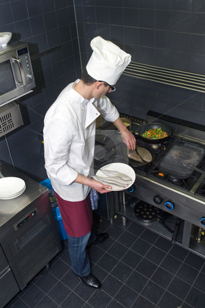 Frying sole stock photo, Chef in the process of frying dover sole in a professional kitchen by Corepics VOF