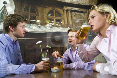 Having a beer stock photo, Three young men drinking beer in a bar by Corepics VOF