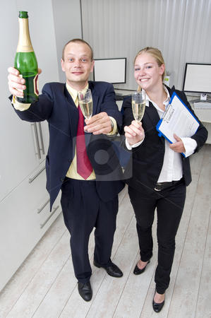 Business celebration stock photo, Two colleagues celebrating a business deal with a bottle of champagne, holding the file with the signed contract by Corepics VOF