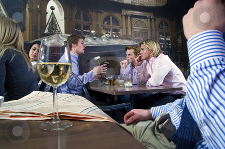 Cafe crowd stock photo, Several customers having a discussion in a bar by Corepics VOF