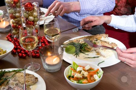 Restaurant dinner stock photo, Group of friends enjoying their christmas dinner in a restaurant by Corepics VOF