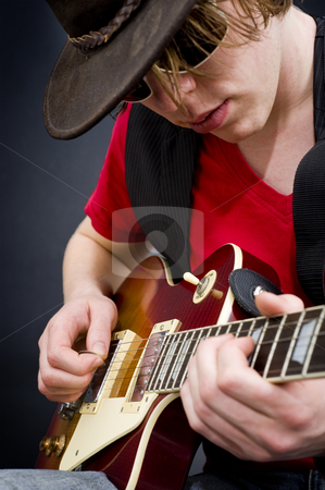 Blues musician stock photo, A blues guitarist playing a tune on his instrument by Corepics VOF