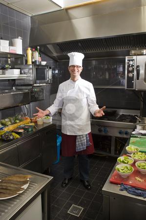 Chefs Kitchen stock photo, A chef in his kitchen, preparing dinner by Corepics VOF