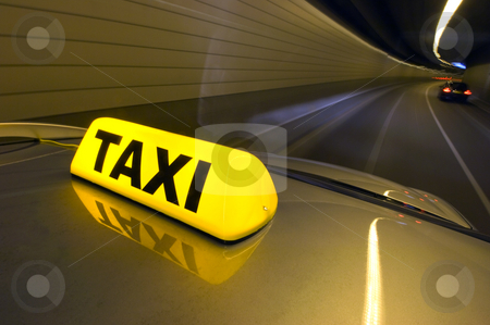High speed taxi stock photo, A taxi, racing through a tunnel overtaking cars by Corepics VOF