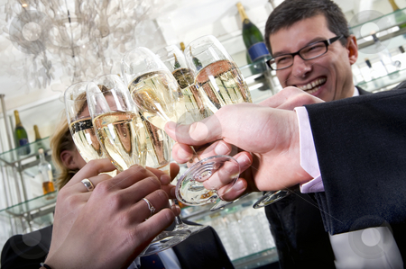 Toasting with champagne stock photo, Several people toasting with champagne on new years eve by Corepics VOF