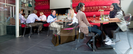 Restaurant interior panorama stock photo, A panorama of a restaurant with eight people enjoying a drink by Corepics VOF