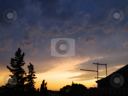 Sunset scene stock photo, View of the tranquil, evening sky above the city after the storm. by Sinisa Botas