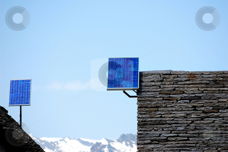 Solar panels stock photo, Solar panels on mountain houses roof by ALESSANDRO TERMIGNONE