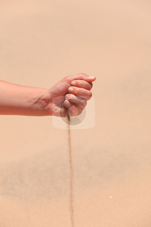 Arabian sand stock photo, Close-up of hand holding Arabian sand in desert by Tom P.