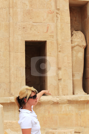 Female tourist  stock photo, Female tourist looking at Queen Hatchepsovet Temple, Egypt by Tom P.