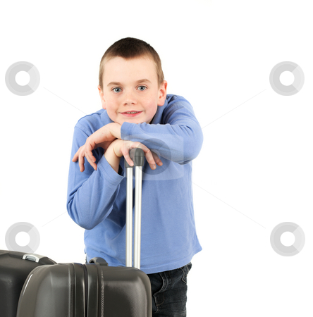 Child with suitcase stock photo, Portrait of young boy with suitcases, studio shot by Tom Prokop