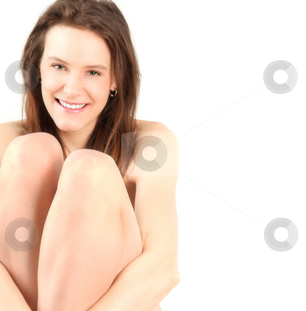 Naked girl smiling stock photo, Portrait of young nude woman sitting, studio shot by Tom P.