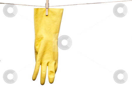 A horizontal image of a single yellow rubber glove hanging on a  stock photo, A horizontal image of a single yellow rubber glove hanging on a clothes line by Vince Clements