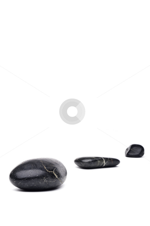 A vertical image of 3 river rocks arranged in a line with space  stock photo, A vertical image of 3 river rocks arranged in a line with space for copy by Vince Clements