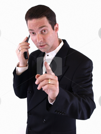 Just a Minute, Please stock photo, A man in a black suit holds up his finger to signal he is busy and on the telephone. by Robert Gebbie