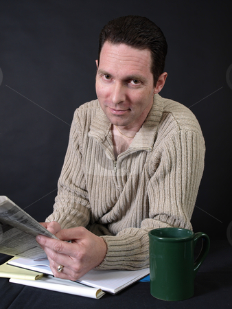 Job Searching stock photo, An adult male looks through the employment ads in his local paper. by Robert Gebbie